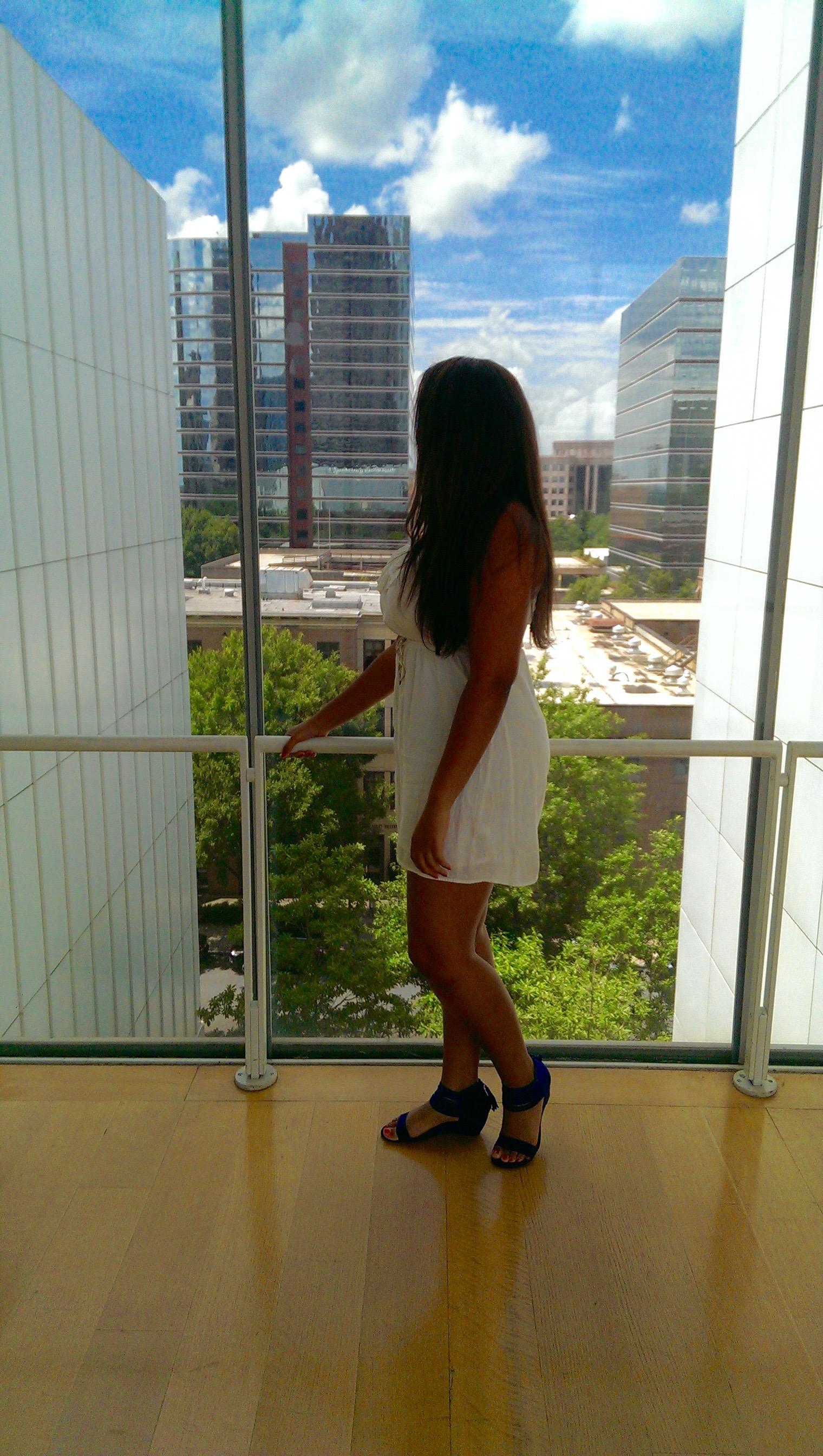 The High museum of Art Atlanta views brunette girl in white dress