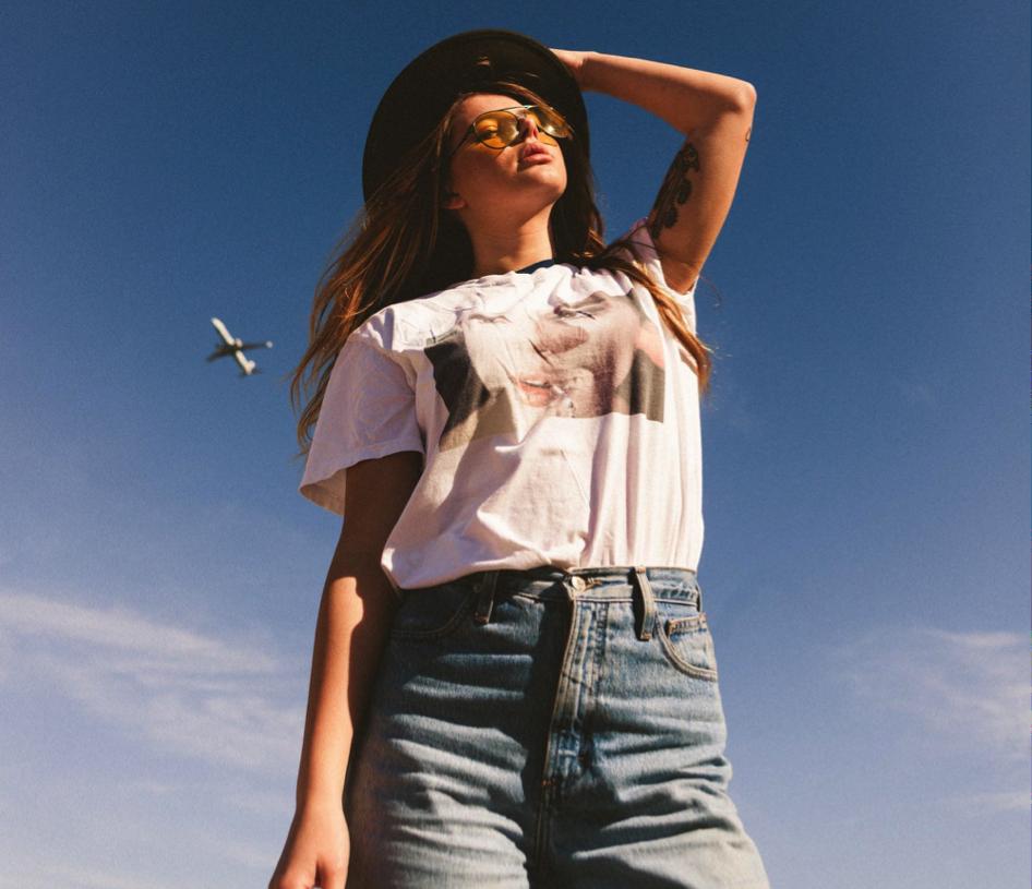 yellow aviator sunglasses and jeans