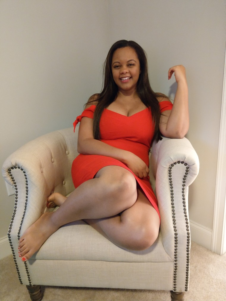 Laughing in a Red Abercrombie and Fitch dress and off white tufted studded chair