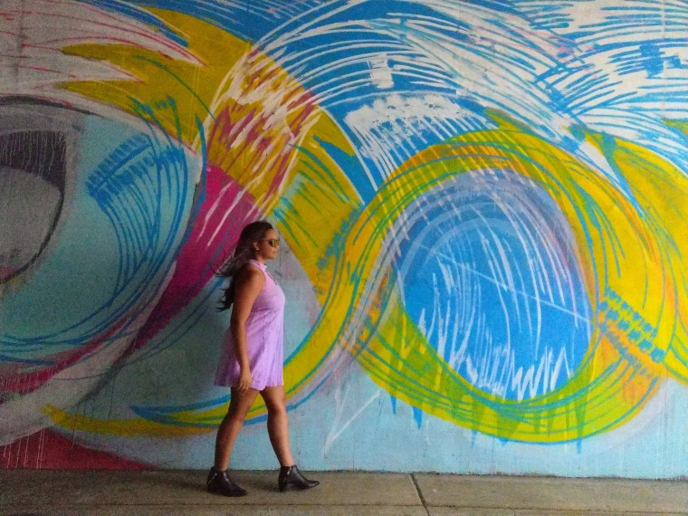 Atlanta street style and graffiti with black ankle boots and a lavender dress
