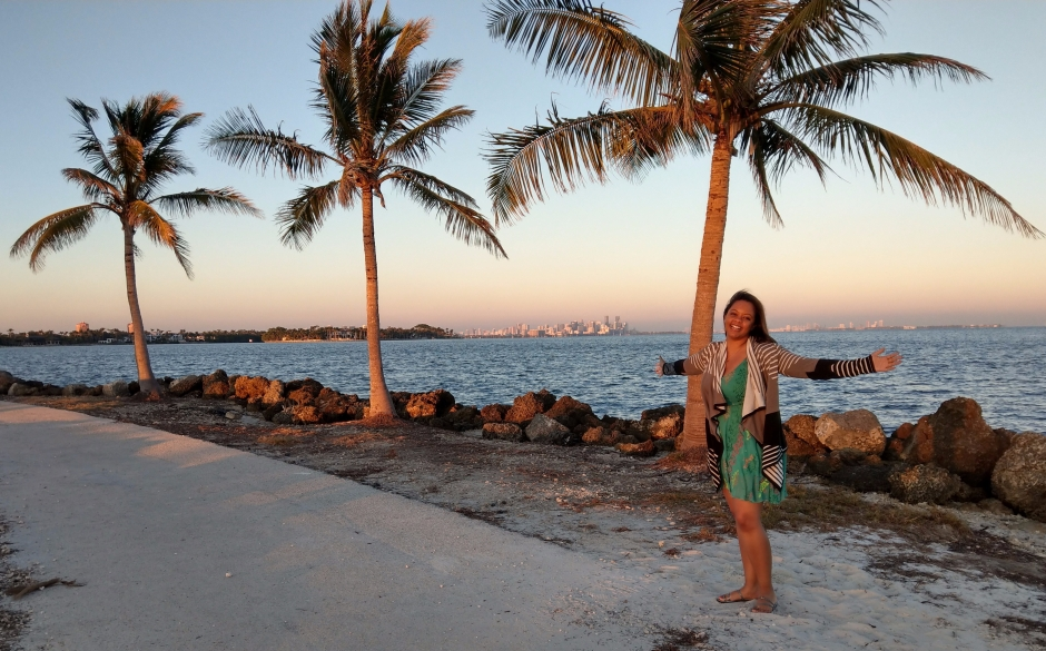 three palm trees in Miami, Fl. Happiness at sunset. Beautiful care free black woman