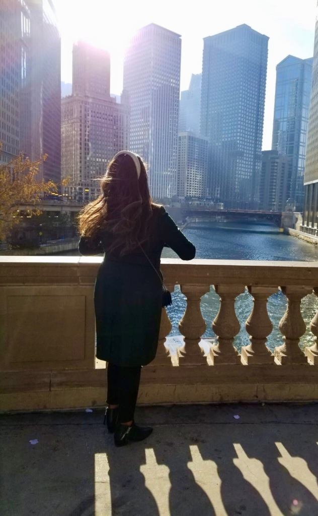 Thick brunette hair, Chicago, princess, looking at the river, downtown Chicago, emerald green Ted Baker coat.